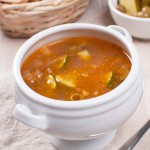 Tomato soup with fish, olives and lime